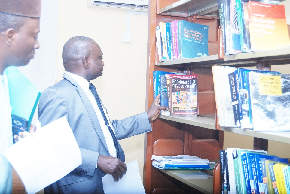 The Vice-Chancellor, Prof. Kolawole Salako, inspecting some sets of books on display in the CEADESE library