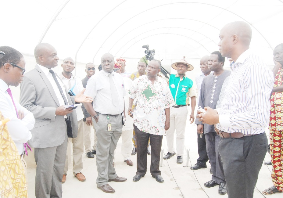 The Vice-Chancellor, Prof. Kolawole Salako (2nd from left) making some observation at the CEADESE Screen House during the inspection tour, while other members of the inspection team pay attention